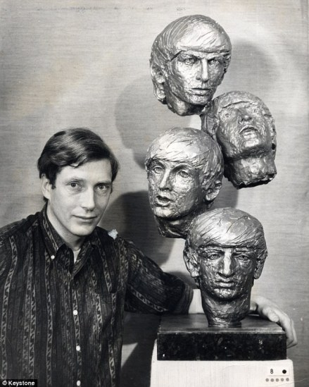 Sir David Wynne with his Beatles busts.