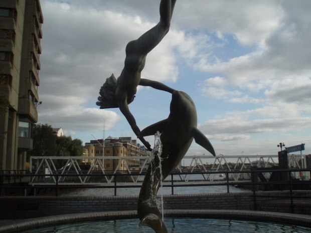Girl With a Dolphin, sculpted by Sir David Wynne in 1973. (Image via Geograph; copyright Paul Gillett).