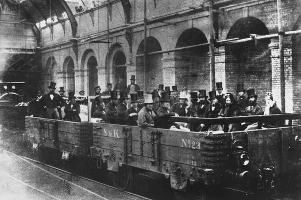 VIPs gaining on a sneak preview of the Metropolitan Railway.