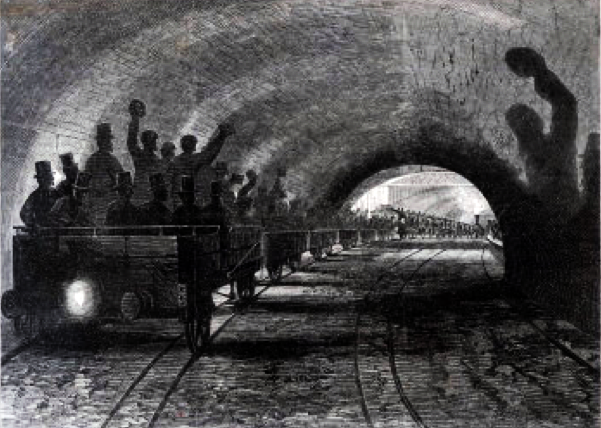 Open wagons rumbling through the world's first underground railway... no need for air conditioning here!