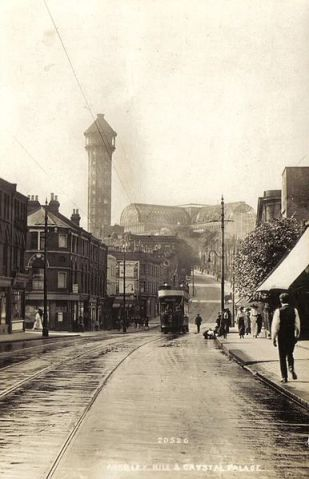 Happier days... Crystal Palace & one of Brunel's water towers, as seen from Anerley Hill (image: Wikipedia).