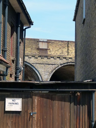 The arches pass Blue Anchor Lane.