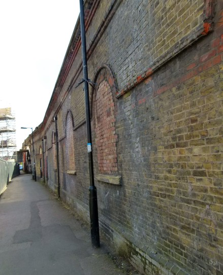 Bricked up windows of the former Southwark Park Station.