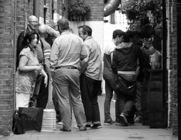A group of drinkers gather outside Two Brydges Place.
