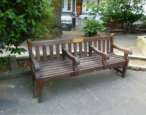 Kirsty MacColl's memorial bench can be found on the southern side of Soho Square, towards Greek Street.