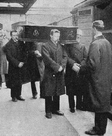 A coffin being loaded onto one of the Necropolis Railway carriages.