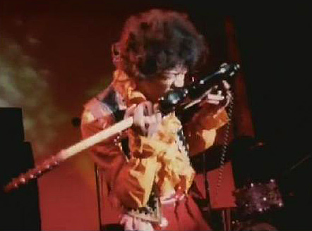 Jimi Hendrix playing with his teeth