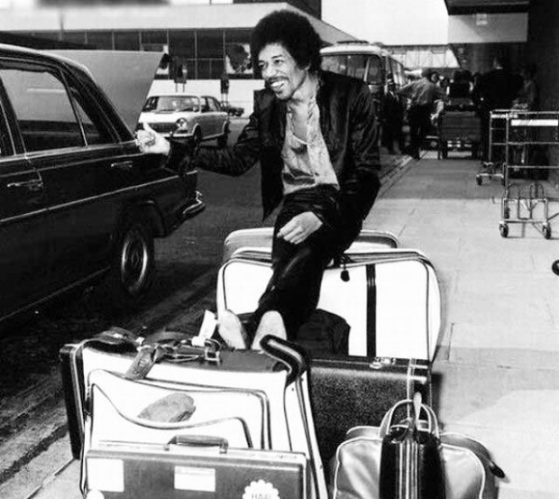 Jimi Hendrix pretending to thumb a lift at Heathrow, 1970