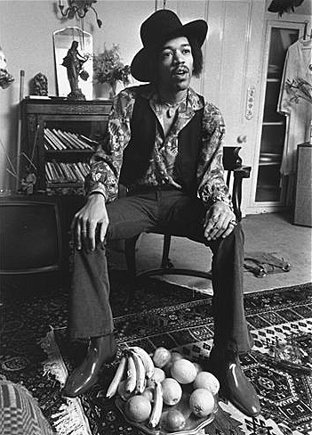 Jimi posing for a photo shoot at 23 Brook Street, 1969