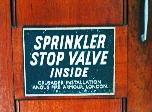 A somewhat ironic sigh attached to a door within Clifford's Inn Passage