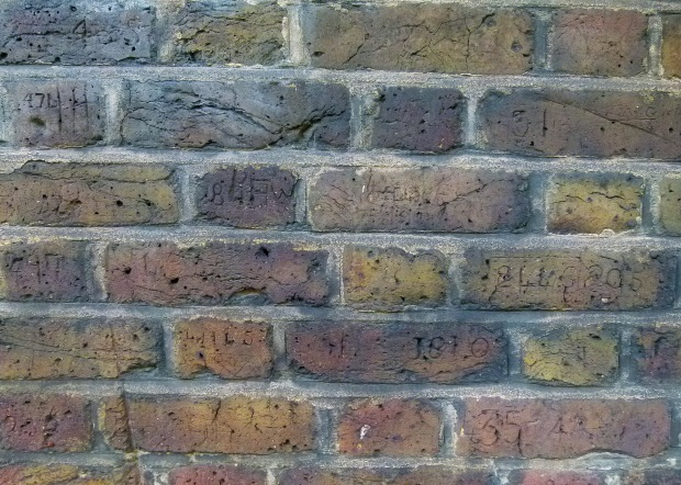 The policemen's numbers can be seen carved over much of the Myddelton Passage wall...