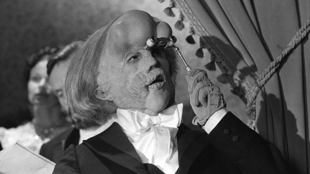 Sir John Hurt as Joseph Merrick